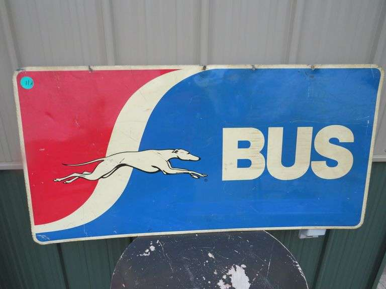 """Vintage 48"""" x 24"""" two-sided metal Grey Hound sign"""