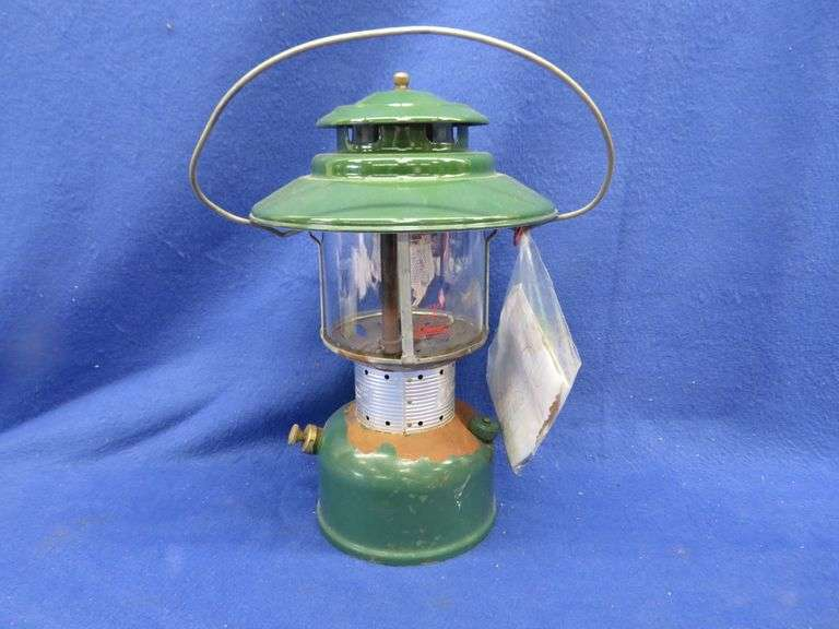Old double-mantle Coleman lantern with bent handle