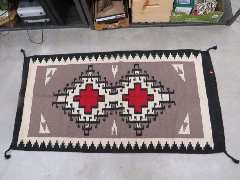 "Southwestern-style woven 64"" x 32"" rug"