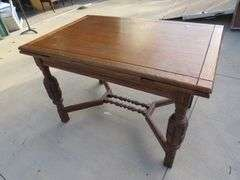 Depression-era draw leaf table and four matching chairs