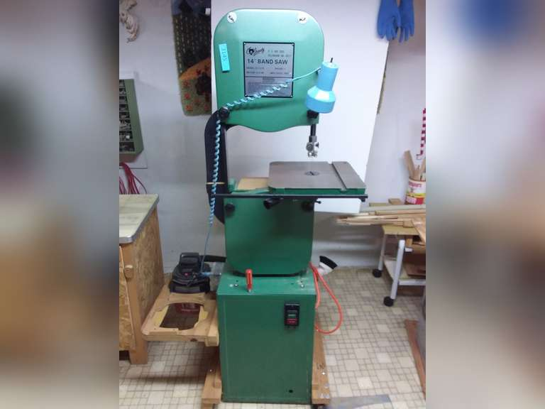 "Grizzly 14"" Band Saw Model G1019 3/4 HP motor.  MFG Date 1993. Mounted on base with shop vac attached.  Unable to test set up for 220.  Item located in basement will need additional help for removal of this item"