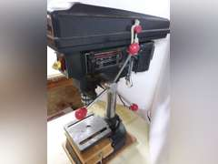 Craftsman 8 inch 3 speed 1/6 hp drill press mounted on home made cabinet with 2 wheels.  Tested and does work. Very clean, comes with additional jigs.   Item located in basement will need additional help for removal of this item