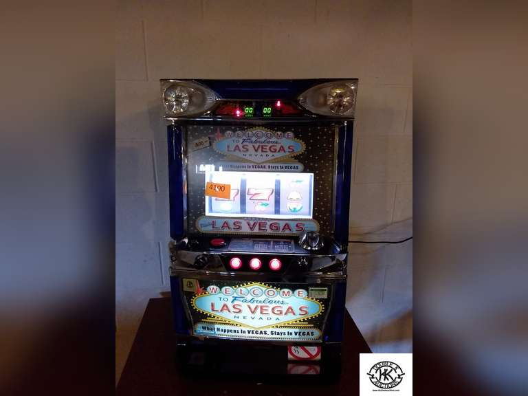 Operating Las Vegas Slot Machine, in good working condition.  Comes with 3 tolkens.