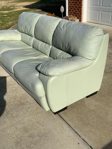 """Green Leather Sofa with attached cushions 82"""" long x 38"""" wide"""