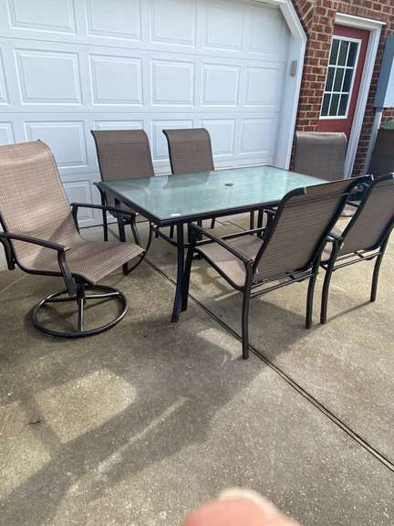 """Patio Table with 6 chairs, some rust, table measures 62"""" x 36"""" x 28"""" tall"""
