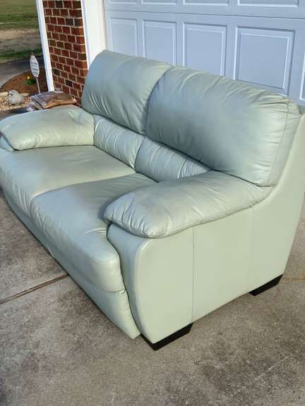 """Green Leather Loveseat 62"""" long x 38"""" cushions are attached"""