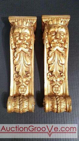 Two decorative pillars with gace design and faux gold color. Each 13x3.5x3.5.
