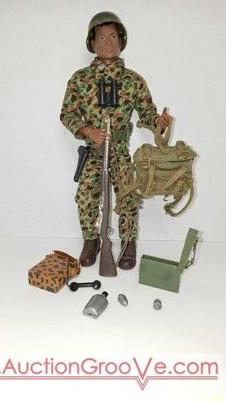 Original 1964 Vintage GI Joe African American Soldier. Accessories include: Rifle, 45 cal pistol, holster, binoculars, belt, radio, canteen, two hand grenades, ammo box, backpack, boots and helmet. He's missing the index finger on his left hand but he can still handle a weapon. Multiple photos for details. Reserve only $500