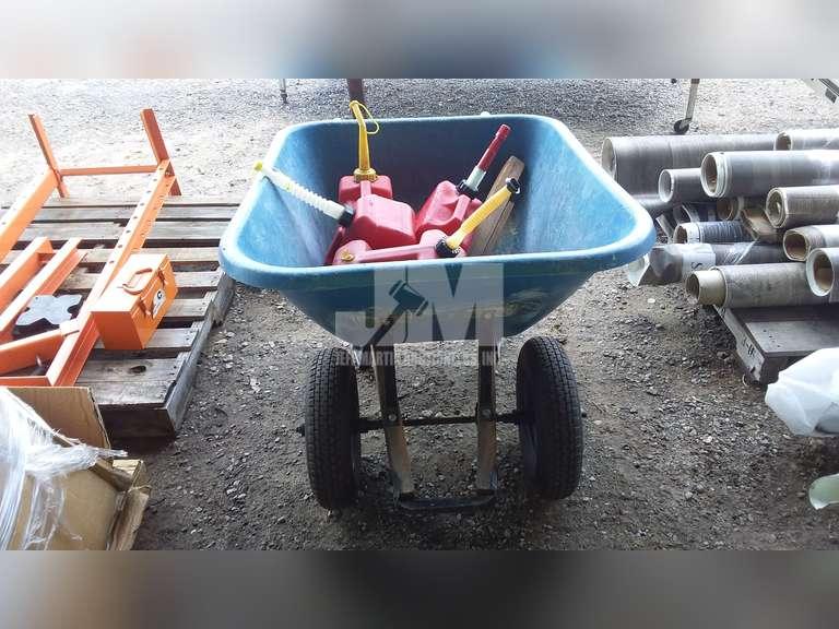 DUAL WHEEL BARREL W/ GAS CANS