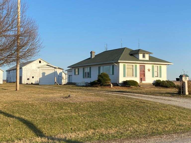 Country Home with 2-Car Garage & Multiple Outbuildings on 4+/- Acres!