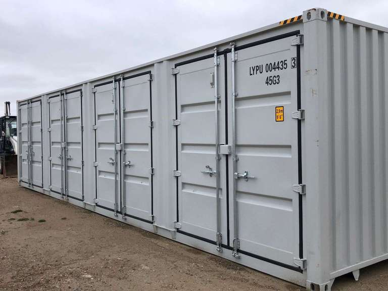 Fabric Buildings, Skid Steer Attachments & More Auction